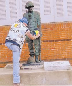 Timmy Bates paid tribute by visiting the veterans memorial at the Letcher County Courthouse. (Photo by Ronna Miles)