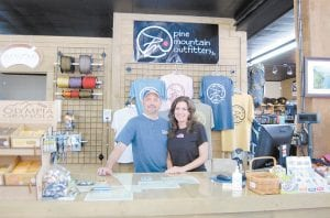 Bill and Patricia Bentley, of Whitesburg, own and operate Pine Mountain Outfitters. A grand opening event for the outdoor retail store, which is located in the old Caudill Lumber Company building at Ermine, will be held June 2.