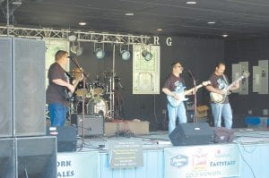 The Pure and Simple Band performed at the Agrestic Music and Arts Festival at River Park in Whitesburg on May 26. The Letcher County band consists of lead vocalist and guitarist Mike Wright, Travis Fields on lead guitar and vocals, Cory Branham on drums and Robert Barnett on bass guitar.