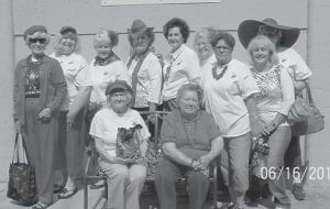 The Red Hatters spent their June outing shopping in Letcher County. The first stop was Annie's Frugal Finery, then on to Vendor's Mountain Mall, then to Isom Vendor's Mall and lunch at Paradise Pizza. Pictured are (front row, left to right) Frances Day, Jean Cook, (back row) Sally Caudill, Ann Reynolds, Marsha Banks, Irene Smith, Vernell Mullins, Ann Bradley, Mary Gilliam, Liz Simon and Frannie Day.