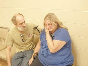 """— Family friend Danny Eldrich tried to comfort Kathy Bentley, mother of Dradrick """"Drad"""" Fleming, after Bentley listened to testimony offered during the evidentiary hearing for her daughter-inlaw Stephanie Fleming and Mrs. Fleming's lover, James Maggard, who are charged with murdering Drad Fleming."""
