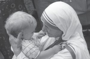 Former Courier-Journal photographer Jay Mather took this iconic photo of Mother Teresa during her visit to Jenkins in June 1982.