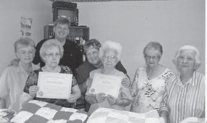Letcher County Judge/Executive Jim Ward presented Mabel Asher and Geneva Sturgill with certificates for the work they did on quilts to be donated to tornado vicitms in Salyersville. Also pictured are Lorraine Kuracka, Debbie Slone, Coleene Hart and Lizzie M. Wright. Not pictured are Vina Lucas and Sharon Amburgey.