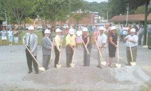 Breaking ground at Tuesday's ceremony in downtown Jenkins were (from left) project engineer Paul Nesbitt, Jenkins Mayor G.C. Kincer, USDA Rural Utilities Program Director Vernon Brown, Pat Wooten, field district representative for U.S. Rep. Hal Rogers, State Rep. Leslie Combs, Jenkins City Administrator Todd DePriest, Donna McClure, field representative for U.S. Sen. Mitch McConnell, and Mike Miller, executive director of the Kentucky River Area Development District.