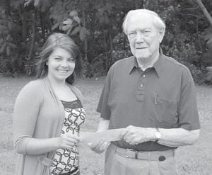 — Emilee F. J. Spangler, daughter of Alvin R. and Juanita Collier Spangler, is the recipient of the Letcher County Teachers Credit Union Scholarship for 2012. She will attend Eastern Kentucky University in the fall to pursue a degree in forensics and chemistry. She is pictured with Jack Burkich.