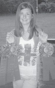 Brooke Saurer earned several ribbons last week in the Letcher County Extension Office fruit and vegetable contest. She received a blue ribbon for each category: tomato, banana pepper, and squash, and earned a white ribbon for another squash. She will also compete in the Kentucky State Fair 4-H program in each of the categories. She is the daughter of James and Valerie Saurer of Partridge, and is a seventhgrade student at Whitesburg Middle School.