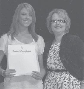 — The Daughters of the American Revolution gave two scholarships and awards to graduates of Letcher County Central High School. Above, Mahala Frazier presented the DAR Good Citizenship Award to Haley Whitaker, daughter of Mr. and Mrs. James Whitaker. Below, Jessica Jones, daughter of Leeann Jones, received the DAR Junior ROTC Scholarship and Award. Marsha Banks presented the award.