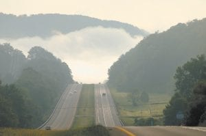 — Morning fog was still nestled in the foothills of the Appalachian Mountains when this photo was taken Sunday looking east on the Mountain Parkway near Stanton. (Photo by Chuck Johnson)