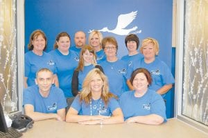 Staff of the new Whitesburg Women's Center posed for a photo during the open house on August 16. Picured are (front row, left to right) Barry Amburgey, Tricia Baker, Crystal Gibson, PA-C, (second row) Dr. Jessica Branham, Sharmayne Hale, Lisa Adams, Libby Blair, (third row) Thelma Yonts, Tonya Colins, Tom Adams and Jennifer Herrell, CNM.