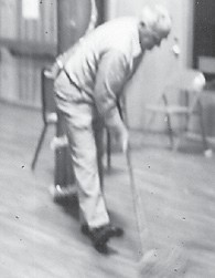 The late Clyde Hatton, husband of Whitesburg correspondent Oma Hatton, is pictured the first time he ever held a mop. It was at a Howard reunions a long time ago.