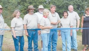 Above, preparing to cut a ribbon marking the end of the first construction phase of the Pioneer Horse Trail atop Pine Mountain near Whitesburg were Kentucky First Lady Jane Beshear, Letcher Judge/Executive Jim Ward and his wife Joan, and Craft's Colly resident Jimmy McIntosh, who spearheaded the effort in 2005.