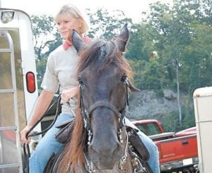 At right, Mrs. Beshear, who describes herself as a horse enthusiast, began her trail ride.