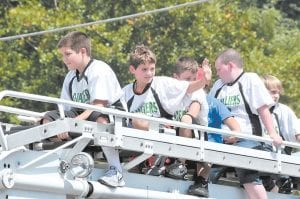 RIDING HIGH — Members of the Jenkins Middle School football team rode through Saturday's Homecoming Days Parade atop a Jenkins Volunteer Fire Department truck.