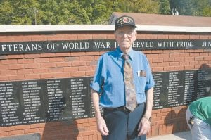"WORLD WAR II VET — Orlando Collins of Payne Gap was photographed standing in front of a World War II memorial built in honor of Collins and other veterans who served in the ""People's War"" that was fought between 1939 and 1945 to stop the aggression of the armies of Germany and Japan. (Photo by Chuck Johnson)"