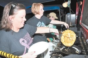 FESTIVAL TREAT — Funnel cakes prepared by members of the Burdine Freewill Baptist Church are a staple of the annual Jenkins Homecoming Days Celebration.