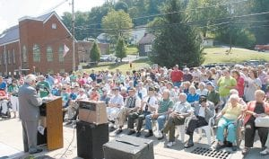 Jenkins Mayor G.C. Kincer addressed a large crowd which filled the city's Main Street on Saturday for the unveiling of a monument to honor World War II veterans from Jenkins, Dunham and Burdine. The monument was designed by Richardson Associates Architects of Whitesburg and built by Blair Construction. (All photos by Chuck Johnson, except photo at middle right courtesy of Richardson Associates.)