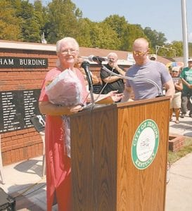 Mary Ann Mullins spoke to the crowd at the unveiling for the World War II Veterans Memorial in Jenkins after being presented with a bouquet of flowers in honor of her work in spearheading the effort to get the monument designed and built.