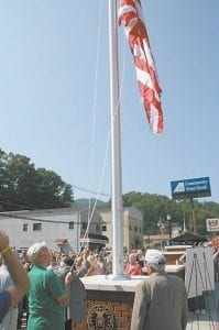 Herbert Ray Short, left, a World War II veteran from Jenkins, helped raise the flag during the ceremony.