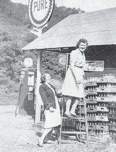 Sadie Mosgrove climbs a ladder at the Owl Café.