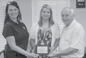 PRIDE's Tammie Wilson presented a trophy to Jenkins PRIDE Coordinator Mason Tackett and Mayor G.C. Kincer for the city's outstanding increase in Spring Cleanup volunteers from 2011 to 2012.