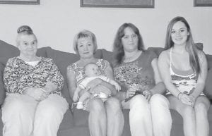 — Pictured are (left to right) Ruby Branham of McRoberts; her daughter, Mary Roark of Indiana, holding her great-great-grandson, Benjamin Ray Barger, born June 24; her granddaughter, Stacia Fleming Day of Indiana; and her great-granddaughter, Taylor Day of Indiana.