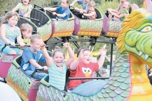 Letcher County's fall festivals move to the City of Neon this week for Neon Days after stopping in Isom over the Labor Day weekend for Isom Days 2012 at the Isom Fairgrounds. In the photo above, children enjoyed one of the many rides offered on the carnival's midway.