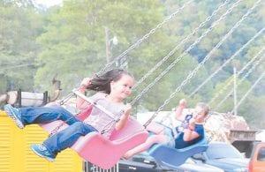Jasmine Caudill enjoyed the swings at the Isom Days carnival.