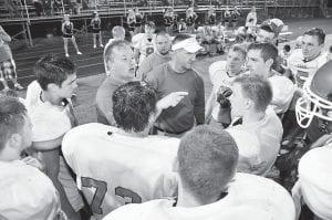 Jenkins head coach Eric Ratliff directed his team during a break in the action in last Friday's game against South Floyd. The Cavs, who gave up 44 points in the first half, mounted a valiant comeback in the second half but still lost 50-36. (Photo by Chris Anderson)