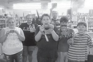 The Lillian Webb Memorial Library in Fleming-Neon held pie tasting and pie eating contests on Sept. 8 as part of the Neon Day events. Contestants for the pie eating contest were (left to right) Lauren Hall, Sara Hall, Damian Fletcher, Eric Tackett, Caleb Stamper and Nathanial Champion. The first place winners of the pie eating contest were Lauren Hall in the 15-25 year old category, and Damian Fletcher in the 5-15 years old. First place winner of the pie tasting contest was Richard Stewart with his apple cranberry pie and second place went to Tazsha Hall with a banana split pie in a waffle cone crust. First place winners received a $25 Walmart gift card and second and third place winners received a movie or CD. Judges were Jeanette Ladd and Pearl Goode.