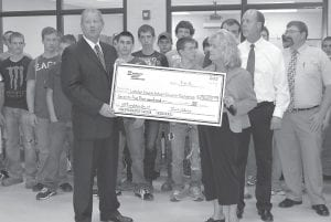 Kentucky Power President and COO Greg Pauley presented a check for $75,000 to Letcher Schools Supt. Anna Craft for the Letcher County Area Technology Center of behalf of the American Electric Power (AEP) Foundation.