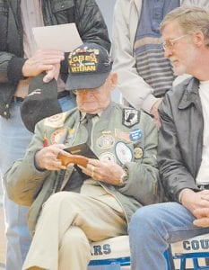 Jimmy Duncan, a former prisoner ofwar in Korea, looked at a plaque given to him during the Veterans Day program at Letcher County Central High School on Nov. 11, 2011. Duncan, who was decorated with a Silver Star, died last week.
