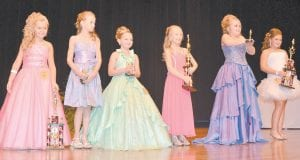 — Raygan Anderson won the title of Tiny Miss at the Mountain Heritage Festival Pageant held Monday night at the Letcher County Central High School auditorium. Triniti Whitaker won runner up. Baylee Caudill won photogenic. Pictured left to right are Triniti Whitaker, Cammie Lucas, Haryley Driskell, Baylee Caudill, Lindsay Baker and Raygan Anderson. (Photo by Connie Fields)
