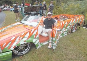 Steve Robinson of Galax, Virginia showed off his bright orange and green 1986 Mazda truck at the Heritage 2K12 Truck and Car Show in Whitesburg. (Photo by B.J. Johnson)