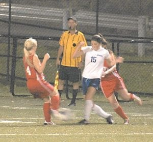 Letcher County Central High School's girls' and boys' soccer teams won matches at home last week. In the photo above, LCC forward Brittney Buttrey (15) battled for the ball in the Cougars' 2-1 win over Belfry. Below, Zach Joseph (6) defended a Buckhorn player during a 10-0 win by the boys' team, which improved to 6-4 on the season. The girls have a record of 5-2 after an 8-0 win over Shelby Valley on Sept. 8. Both teams will play at home against Estill County this Saturday. The boys play at 12:30 p.m. and the girls play at 2:30 p.m.