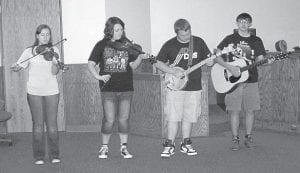 Cowan Creek Music School musicians performing for the Letcher Fiscal Court this week were (from left) Autumn Dollarhide, Rebecca Standifer, Logan Dollarhide and Levi Caudill.