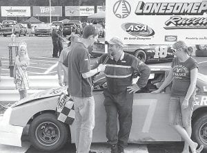 Driver Brad Ball (center) is all smiles as he is interviewed after taking the Mod-4 championship.