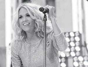 """Carrie Underwood will perform at the KFC Yum! Center in Lousville on Sept. 21 as part of her """"Blown Away"""" tour. (Invision/AP)"""