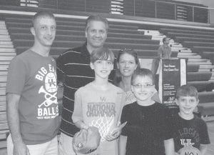 Pictured with University of Kentucky basketball coach John Calipari are Steve and Jaime Hall of Mt. Sterling and their sons Steven Tyler, 12; Zachary Clay, 10, and Mason Alexander, 8. Steve Hall is the son of Eugene and Kathy Hall of Deane, and the grandson of Charlie and Wilma Holbrook, also of Deane.