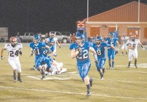 AHEAD OF THE PACK — Letcher County Central's Chris Tyree (22) outran everyone else on the field on his way to a 98-yard kickoff return during the Cougars' game against Russell County.