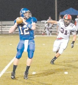 Letcher County Central quarterback Zane Blair found himself under pressure for most of the Cougars' loss to visiting Russell County on homecoming night at LCC. Blair completed eight passes on 15 attempts for 136 yards and a touchdown. See story on Page B8.