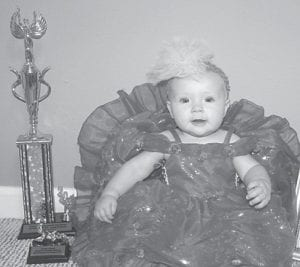 — Carlyn Ruth Lee, six months, won Most Photogenic in her age division at the Mountain Heritage Baby Pageant. She is the daughter of Ryan and Machaela Lee of Pound, Va. Her grandparents are Roy and Carlene Mullins of Eolia, James Lee of Haymond, and Deborah Counts of Big Stone Gap, Va. Her great-grandparents are Carl and Ruth Church of Eolia.