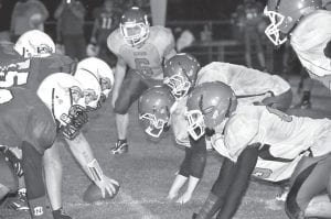 The Knott Central offense and Jenkins defense faced off late in the game during the Cavaliers' 28- 21 loss to at Hindman. Turnovers, including four fumbles in the first half, doomed Jenkins. The loss drops the Cavs' record to 4-2 on the season as the team enters its district schedule this week against the 3-3 Pineville Mountain Lions on the Jenkins field. The loss also ended a long 36-game losing streak for the Patriots in circumstances similar to last season when Jenkins defeated Knott Central to end its own losing streak which had spanned several seasons. (Photo by Chris Anderson)