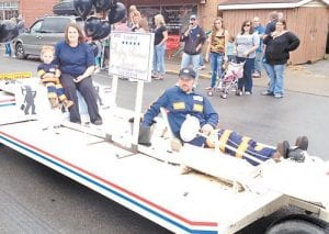 The family of Rylie Renee Lucas, runner-up in the 13-18 months category of the Mountain Heritage Baby Pageant, highlighted the parade's coal-related theme by securing a mine buggy for her ride through Saturday's parade.