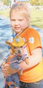 WINNERS — Britney Bolling and her dog Princess won first place in the Best Dressed category in the Mountain Heritage Dog Show. They also won second place in the Lookalike category. Both were dressed in the theme of coal mining. Britney is the daughter of Natasha and Mathew Bolling of Deane.