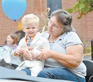 Baby pageant winner Connor Craft squinted as the sun began to shine on the parade. (Photo by Chris Anderson)