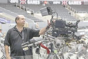 ESPN coordinating producer Phil Orlins showed a 3-D camera set up used by ESPN 3-D Network coverage at the ESPN X-Games held at the Staples Center in Los Angeles earlier this year. Only 2 percent of TVs in American homes were able to show 3-D last year, according to IHS Screen Digest. That's about 6.9 million sets out of 331 million installed. (AP Photo)