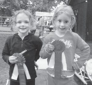 — Macey Warf (left), daughter of Brandon and Tracy Warf, won first place in the ARH cupcake decorating contest during the Mountain Heritage Festival. Her grandparents are Fred and Sue Webb of Mayking, and Bobby and Terry Warf of Payne Gap. Hailey Sexton (right) won second place. She is the daughter of Donnie and Crystal Sexton of Isom. Her grandparents are Rick and Tammy Amburgey. She is the great-granddaughter of Hargis and Georgia Amburgey.