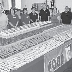 Two thousand cupcakes were donated and decorated on site at the Mountain Heritage Festival by Food City employees Shaun Marcum, Carolyn Lucas, Sherry Johnson, Sherry Caudill, April Lucas, Vanessa Sandlin and Anna Slone. Members of the Mountain Heritage Festival Committee say they appreciate the donation from Food City for the festival's 30th anniversary.