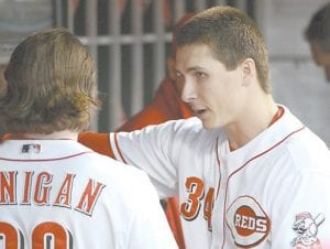 Cincinnati starting pitcher Homer Bailey (right) talked to catcher Ryan Hanigan during Tuesday's game. Bailey gave up only one hit over seven innings, but it wasn't enough to send the Reds to their third win in the NL Division Series, which was scheduled to resume Wednesday. (AP photo)