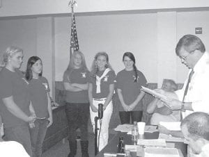 Letcher County Judge/Executive Jim Ward read from certificates of appreciation on Monday night to 2012 Mountain Heritage Festival Parade Ambassadors (from left) Katelyn McCall, Erica Webb, Sara Gilley, Sara Baker, and Abby Frazier. (Photo by William Farley)